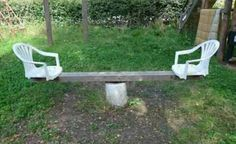 Homemade Playground Equipment - this is rough looking but with the right chairs and the right paint it could be AWESOME.
