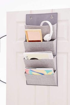 Urban Outfitters Aldo 4-pocket hanging organizer. Soft but durable 4-file organizer that packs flat for easy moving and storage. Perfect for organizing notebooks, papers, magazines, electronics and other odds + ends. Hang it on the wall or over-the-door for an easy, instant shelving space. #fortheoffice #organizing #ad #magazineorganizer #officeideas #officestorage #mompreneurs #homeoffice