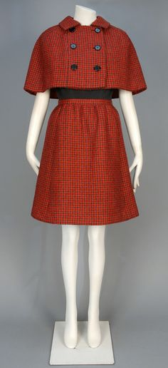 ID 144-63 NORMAN NORELL WOOL DAY DRESS and CAPE ENSEMBLE, 1960s.