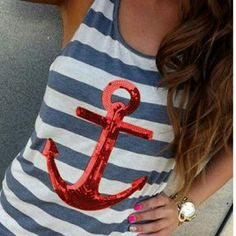 NWT Nautical tank NWT Nautical tank. Navy and white stripes with red sequin anchor. Please note that this shirt may run a little small Tops Tank Tops