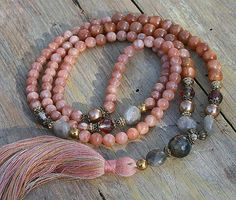Mala necklace made of 6 and 8 mm - 0.236 and 0.315 inch, beautiful sunstone gemstones. Together they count as 108 beads. The mala is decorated