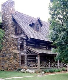 Love the style of this log home and the stone chimney...look at the porch rail made out of twigs...awesome!!