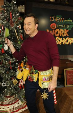 the chew's Clinton Kelly makes Christmas ornaments.  Glittered lightbulb snowman, cupcake ornament, & peanut reindeer.