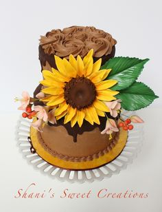 A birthday cake for a lady who loves sunflowers and chocolate. Dark chocolate cake filled with dark chocolate fudge and frosted with chocolate mousse Swiss buttercream and chocolate ganache. Beautiful Cakes, Amazing Cakes, Fondant, Sunflower Cakes, Ganache Cake, Food Decoration, Decorations, Dark Chocolate Cakes, Sugar Craft