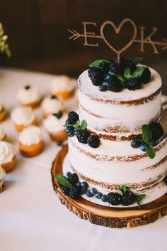 Navy Blue & Yellow Summer Wedding | Kate & Eric info@warrenwoodmanor.com Ivory naked layered cake with blueberries and blackberries on a wood slab with a wood cake topper