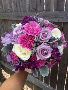 Wedding bouquet of Ocean Song lavender roses, amethyst stock, fuchsia carnations, lavender Caspia, white roses, dusty miller, brunia, crystals