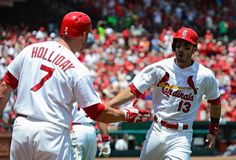Matt Carpenter celebrates with Matt Holliday after hitting a solo home run during the first inning against the New York Mets. 6-18-14
