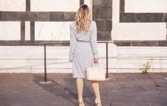 Baby blue Balmain cardigan, grey Balmain tee, grey Balmain skirt, cream Givenchy Antigona bag and cream Casadei boots