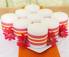 Make a spring-fresh centerpiece by grouping inexpensive candles, then embellishing them to fit your decor.