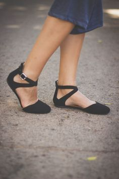 This black strappy flat is great for day to day wear. With the closed toe and ankle straps it makes this shoe perfect for any occasion. *Black matted faux suede *Silver buckle with two straps *Rounded closed toe