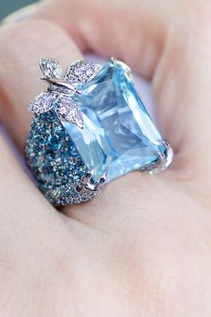 "Whimsical and beautiful, this diamond butterfly ring by Adolfo features a lucid 30.90ctw blue topaz. The shank is studded with blue sapphires. Ring size is a 6-1/2 and the dome is .75"" wide."