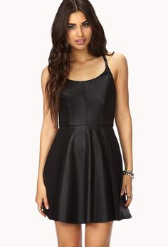 A faux leather skater dress featuring crisscross spaghetti straps. Round neckline. Knit panels. I...