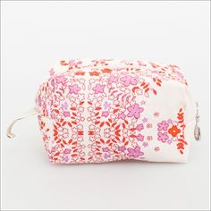 <p>A sweet cosmetic bag for pretty gifting for you or someone else. These beauties nest easily inside each other and feature a cotton voile exterior with a waterproof plastic lining and a cotton twill pull tab.</p>