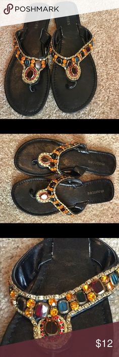 Maurices black with bling detailing. Size 8 Great pair of thong sandals with multi color bling. All beads in tact. Very pretty on. Worn once. Size 8. Maurices Shoes Sandals