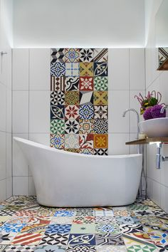 Here, a patchwork of colourful Moroccan tiles from Encaustic Tiles makes a feature of the floor, and strikes a contrast with the minimalism of the white tiles on the wall. Description from houzz.co.uk. I searched for this on bing.com/images