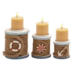 Highlighted by spools of jute rope and nautical details, these fir wood candleholders lend welcoming coastal appeal to your console or dining room table.