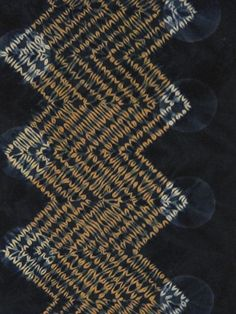 Mokume zig-zag  Rust-dyed cotton calico, stitched and gathered, dyed with indigo, discharge printed.