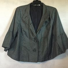 Sparkly jacket. This is a cute little blazer. Black with a white checked line with sparkling silver accent. The blazer is 25 inches long with 19 1/2 long sleeves. The sleeves have a ruffled type cuff. Studio works Jackets & Coats Blazers