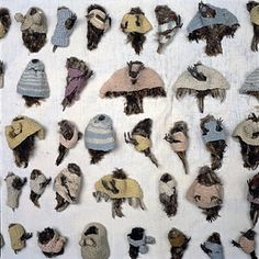Annette Messager - Le repos des pensionnaires, 1971. Installation of taxidermy sparrows in knitted jumpers!