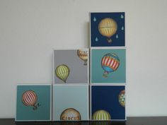 A fabulous vintage-style wall decoration! Each mini canvas measures 10cm x 10cm (4'' x 4'') and is 3.5cm (1'') thick. I've covered the front of the canvas in thick, quality coloured paper in a range of delicious colours: mint, deep blue, taupe and jade green and featured a vintage-style hot air balloon from gorgeous Italian paper.    Whimsical and funky, these mini canvases look great hung in a group on a livingroom wall, or as a quirky addition to your bookcase or bed side table