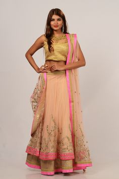 Lehenga by kalanjali #lehenga #blouse #dupatta#Sweet pastel pinkish shade designer semi stitched lehenga over layered net is enhanced gold embroidery work with tissue board immense border which add fashionable style to this finery. Available matching blouse with net embroidered dupatta, embellished pink piping.