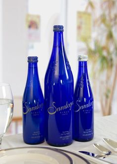 Using local, recycled Saratoga Springs glass water bottles as table name holders. Place corks in the top, wire and cardstock. Each table will have the name of one of Saratoga's springs!