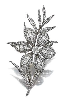 DIAMOND BROOCH,  EARLY 19TH CENTURY. Designed as a floral spray centring on a flower head set en tremblant, set with cushion-shaped, old mine, circular- and single-cut diamonds, later pin fitting, accompanied by a case by S.J.Phillips Ltd.