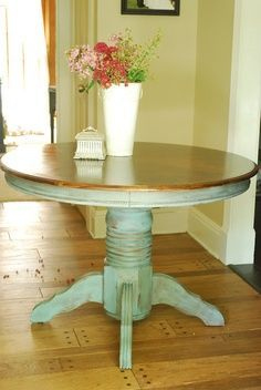 repurposed round table -OMG, here is the table that I am going to refurbish, except I am using black with the turquoise!