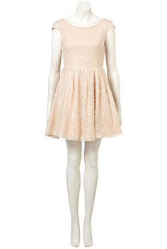 OHGOD. Another NYE dream.  Full skirted prom dress with nude allover sequins and low V cutout back.