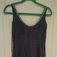 Free People dress 》Like new!! Like new excellent condition! Gray ruffle free people dress with zipper on side and ribbons to tie in the back. Knee length. So great for summer. Free People Dresses