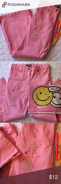 """pink • flare• detailed • jeans Pretty!! Have your princess pretty in pink💝 Beautiful floral design on the left leg. These pink jeans have 5 functional pockets. Button and zip closure. Medium weight. Flare leg has a 1.5"""" slit on the outside. Perfect for those riding or tall boots she wants. Flare is 9"""". Waist 12"""". Hips 14.5"""". Cotton. ccatsmeoww Bottoms Jeans"""