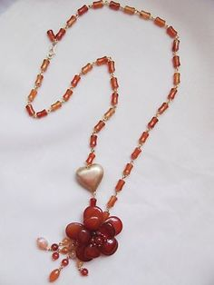 necklace: sterling silver in vermeil and carnelian