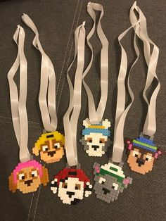 Homemade medallions made of Paw Patrol beads. Available Characters: -Chase -Zuma -Everest -Rocky -Marshall -Skye -Rubble Attached to a wide satin ribbon in white. Price per medal 2 €Informations About Medaillen Kindergeburtstag Paw Patrol PinYou Paw Patrol Party, Paw Patrol Birthday, Dog Birthday, Birthday Crafts, Perler Bead Art, Perler Beads, Animal Crafts For Kids, Diy For Kids, Cork Crafts