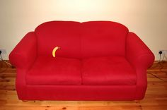 sofa red settee furniture fruit banana domestic interior