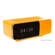 Alarm Dock  Designer: Jonas Damon  Material: Resin and Marble  Dimensions: 6.75 x 3.5 x 2.5 inches    orange - $30.00