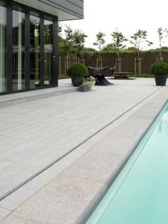 At Naos we we know our way around natural stone. We have stones from all over the world and the best part of the job is finding the best stone for clients. Swimming Pool Tiles, Natural Stone Flooring, Outdoor Spaces, Outdoor Decor, Grey Tiles, Stone Tiles, Natural Stones, Dark Grey, Villa