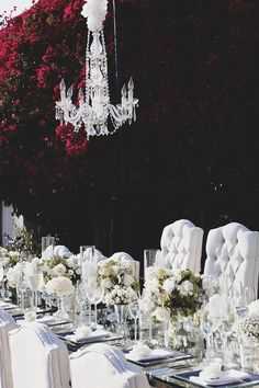UFC Octagon Girl Brittney Palmer and her groom Aaron Zalewski were seated at a 16-foot long table in plush, tufted chairs. A sparkling crystal chandelier was suspended above the mirrored tabletop decorated with mercury-glass vessels filled with an abundance of ivory florals. #BeachWedding #Tablescape Photography: Daniel Kincaid Photography. Read More:  http://www.insideweddings.com/weddings/brittney-palmer-and-aaron-zalewski/595/