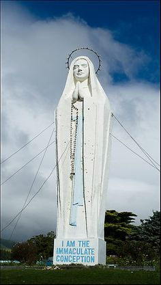 Our Lady of Lourdes hangs out in Paraparaumu Our Lady Of Lourdes, Hanging Out, New Zealand, Statue Of Liberty, Coast, Mary, Places, Travel, Liberty Statue