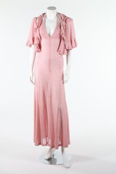 A Biba pink and silver lurex halter-neck dress and matching bolero with flounced edges, early 1970s