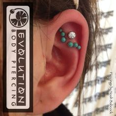 Helix piercings done by Noah Babcock of Evolution Body Piercing. Jewelry by Anatometal.