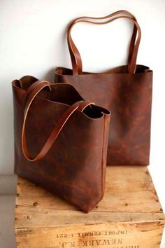 Beautiful, sturdy, brown leather tote. This bag is so classic and simple that it can be worn by just about anyone. A smart and functional tote that translates through seasons and events. Perfect proportions for travel, market , books or your laptop and essentials. paired with thick brown leather straps. Two interior slip pockets good for phone, wallet, keys, cosmetics... Will wear in perfectly over time. A bit of a rustic flare all the while elegant and stylish. measures: (approx) 15.5 in...
