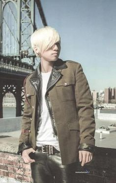 Daesung... military style jacket layered over leather biker jacket and pants