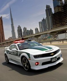 """Dubai Police had recently added a Chevrolet Camaro SS to their fleet for """"highway patrol"""" duties. The Camaro SS is motivated by a and has a top speed of 253 kmph. Police Patrol, Police Cars, Police Vehicles, Police Officer, Bugatti Veyron, Chevrolet Camaro Ss, Corvette, Supercars, Dream Cars"""