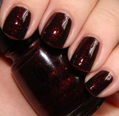 China Glaze Lubu Heels, I wear this most of the time :) At Christmas I get really fancy and switch to Ruby Pumps ;)