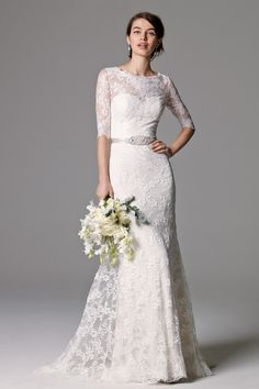 This gown of Ballerina Lace is timeless, with 3/4 length sleeves and a lace illusion scoop neckline. Shown with Chenelle Belt style 8901B (sold separately). Puddle Train. - Watters Riviera