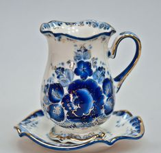 Gzhel,  a style of ceramics, got its from the village of Gzhel, the cradle of Russian  ceramics, which has a history of more than 6 centuries. Originating in the 14th century, as a pottery craft, Gzhel with its painted majolica technique, became famous throughout Russia by the end of the 18th century.