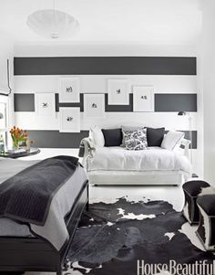 "The bold horizontal stripes in the guest room are ""playful and modern,"" Fulk says."