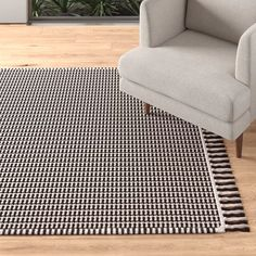 Black Rug, White Rug, White Area Rug, Entry Paint Colors, Rug Under Dining Table, Dark Brown Couch, Tan Rug, Black And White Living Room, Area Rugs For Sale