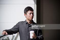ストックフォト : Young man drinking coffee