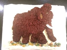 Woolly mammoth cake. Form is Cocoa Krispies then covered with a thin layer of fondant. Fur is chocolate buttercream.
